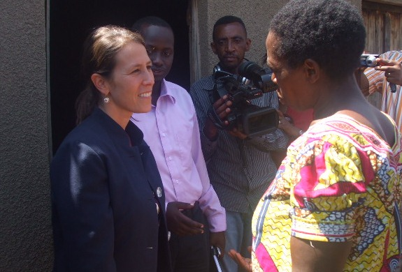 PMI Deputy Mission Director Jessica Lappen talks to an IRS beneficiary in Bugesera district.