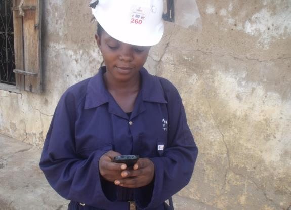 Elizabeth Onawo, a female team leader from Sabon Gari ward in Doma Local Government Area uses text message to communicate with the operations manager and spray operators.