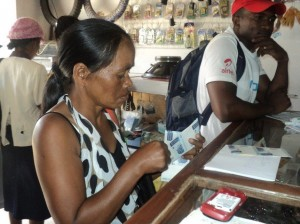 Photo Credit: Mialy Noroarisanjy AIRS introduced mobile banking in Madagascar to process payments to seasonal workers. More than $350,000 was transferred during the 2013-2014 spray campaign. Paulinettte Ranivoarisoa was the first to receive payment through the new system.