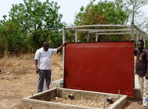 In Benin, AIRS piloted the use of padlocked metal covers on soak pits to reduce the environmental and health risks of the insecticide and to protect project assets.   Photo Credit: Peter Chandonait