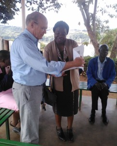 Rear Admiral Tim Ziemer, US Global Malaria Coordinator, discusses malaria cases at the Zindi clinic with the Provincial Medical Director for Manicaland.