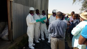 Mr. Samir Awol, a Public Health Officer and Zonal Malaria Focal Person, provides guidance to DDT collection technicians during a practical training session at a district store. Photo: AIRS Ethiopia