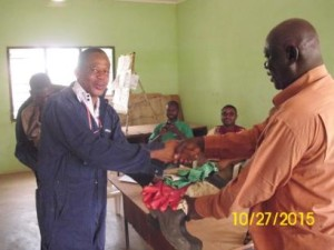 AIRS Ghana donates used but functional equipment to the chairman of the farmers group. The used personal protective equipment was cleaned or decontaminated before the donation. Photo: AIRS Ghana