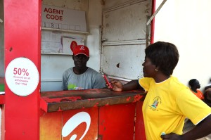 Judy Chisimba, PMI AIRS Team Leader, checks her balance with mobile service provider AIRTEL.