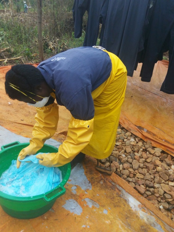 Juliette Mukabusoro, who has a physical disability, washes personal protective equipment. Photo credits: AIRS Rwanda